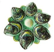 Sale 8828B - Lot 25 - Antique French majolica eel/fish head decorated oyster plate. Diameter 27 cm