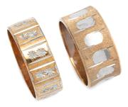 Sale 9037 - Lot 304 - TWO 9CT GOLD BANDS; each in 2 tone gold, a 9mm wide with Florentine engraving and concave features, size L, other 7mm wide with star...