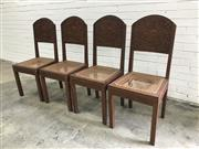 Sale 9080 - Lot 1045 - Set of Four Balinese Heavily Carved Possibly Teak Chairs, the backs with puppet style figures on arabesque ground, caned seats & squ...
