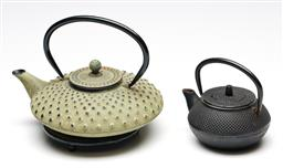 Sale 9246 - Lot 18 - A green cast iron hobnail design teapot on trivet (L:20.5cm) together with a smaller example