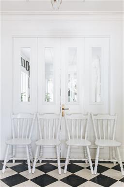 Sale 9200P - Lot 73 - Four classic vintage white painted kitchen chairs, height of back 85cm x Width 42.5cm x Depth 44cm Provenance; Collette Dinnigan's...