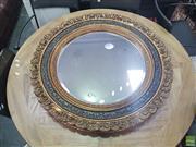 Sale 8648C - Lot 1039 - Ornate Gilt & Ebonised Round Bevelled Edge Mirror