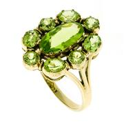 Sale 8763 - Lot 369 - A GEORGIAN STYLE PERIDOT CLUSTER RING; centring an oval cut peridot surrounded by round and oval cut peridots in 9ct gold, size N-O.