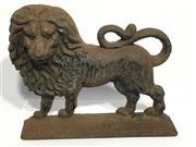 Sale 8600A - Lot 71 - An antique cast iron lion door stop, H 22 x L 27cm.