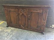 Sale 8976 - Lot 1039 - Antique Rustic Oak Dresser, incorporating early elements, carved with recessed panel work, fitted with a short drawer & two doors, w...