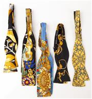 Sale 9080F - Lot 93 - A COLLECTION OF FIVE HERMES BOW TIES; made from 100% silk in various gold patterns including chain link