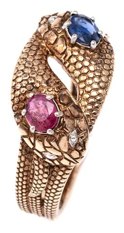 Sale 9115 - Lot 372 - A GENTS 9CT GOLD GEMSET SNAKE RING; featuring 2 entwined guilloche snakes, heads set with a blue oval sapphire and ruby, size T, wt....