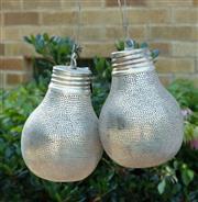 Sale 9066H - Lot 104 - A pair of medium sized Egyptian pierced metal pendant lights of globular form