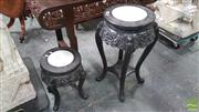 Sale 8402 - Lot 1004 - Two Japanese Carved Graduated Pedestals, with marble panels, the aprons carved with dragon faces & on cabriole legs (leg needs fixing)