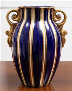 Sale 9140H - Lot 81 - A Wade ceramic blue and gilt twin handled vase, Height 24cm