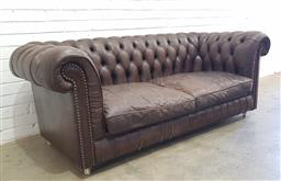Sale 9126 - Lot 1068 - Burgundy Leather Two-Seater Chesterfield Lounge, with buttoned back & two loose cushions, slightly distressed (h:75 w:188 d:89cm)