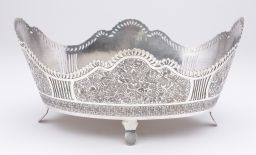 Sale 9150J - Lot 27 - A large heavy hallmarked 840 silver oval centre bowl, the pierced wave edged rim above panels of finely engraved scrolling foliates ...