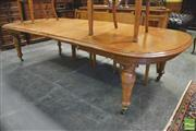Sale 8390 - Lot 1005 - Large Victorian Oak Extending Dining Table, with four leaves, D shaped ends & turned legs
