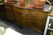 Sale 8523 - Lot 1087 - Timber Bow Front Sideboard with Three Drawers & Four Doors