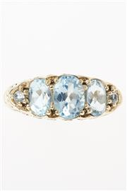 Sale 8564 - Lot 377 - A 9CT GOLD VICTORIAN STYLE TOPAZ RING; set across the top with three graduated oval cut and two round cut light blue topaz, size N-O.