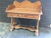 Sale 8976 - Lot 1032 - Probably Victorian Baltic Pine Washstand, with shaped gallery back, two frieze drawers, on shaped supports with stretcher (H:989 x W...