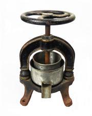 Sale 8828B - Lot 33 - An antique French black cast iron citrus press approx.. 26 x 18 cm