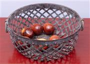 Sale 8891H - Lot 2 - A pierced metal basket with ring handles containing six South African timber eggs, Diameter 26cm