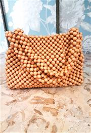 Sale 8577 - Lot 78 - A 1940s amber beaded bag featuring double beaded handle, metal zipper and cloth interior, W 23 x H 18cm, Condition: Excellent