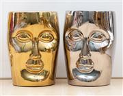 Sale 8703A - Lot 43 - A pair of contemporary ceramic face stools in gold and silver, H x 45cm, W x 31cm
