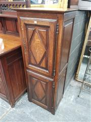 Sale 8868 - Lot 1092 - Tall French Oak Bonnitiere, with two diamond panel doors  (Key in Office)
