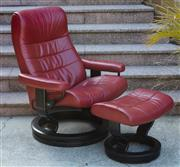 Sale 9066H - Lot 113 - A red leather Stressless recliner and foot stool in cherry red.