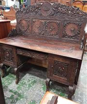 Sale 9068 - Lot 1051 - 19th Century Anglo-Indian Possibly Walnut Sideboard, profusely carved with lotus flowers & leaves, the high panel back with brackets...