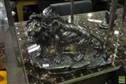 Sale 8523 - Lot 1027 - Stalking Lion Statue