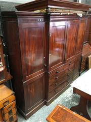 Sale 8666 - Lot 1039 - Late Georgian Mahogany Breakfront Wardrobe, with two panel doors flanked by larger doors, with five drawers having rosewood knobs to...