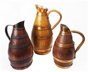 Sale 8828B - Lot 36 - A Set Of 3 Antique French Oak and Copper Cider Jugs. Height range 27-19 cm