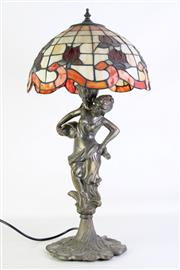 Sale 8905S - Lot 605 - A cast metal figural table lamp with leadlight shade. Height 60cm