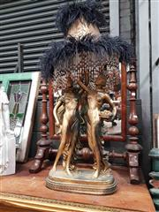 Sale 8925 - Lot 1044 - A figural lamp with ostrich feather and beaded shade