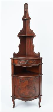 Sale 9080J - Lot 68 - An antique French walnut corner cabinet C: 1910. The carved and shaped back fitted with 2 shaped shelves above the scroll carved fre...