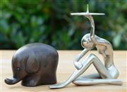 Sale 9066H - Lot 106 - A small metal figural candle holder, together with an elephant.