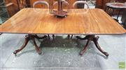 Sale 8375 - Lot 1005 - Georgian Mahogany Sectional Dining Table, with two D-ends and a single leaf (clips in office), raised on turned pedestals with paw f...