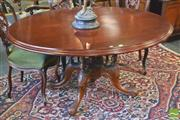 Sale 8390 - Lot 1094 - Victorian Carved Walnut Loo Table, the later oval top on a turned bird-cage base