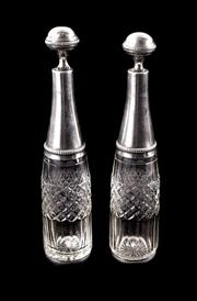 Sale 8828B - Lot 38 - A pair of antique French silver plate top crystal bottles and stoppers, faint hallmarks. Height 28cm