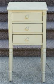 Sale 9066H - Lot 107 - A crème painted bedside table with three drawers. H 81cm.