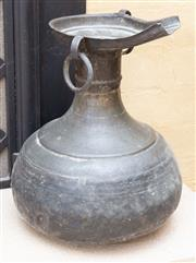 Sale 8550H - Lot 60 - An Indonesian metal ware water carrier with ring handles and globular base, H 40cm