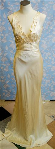 Sale 8577 - Lot 82 - A vintage 1930s silk satin bias cut wedding dress with plunging neckline and applique detail bodice in good condition with some age...