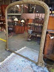 Sale 8598 - Lot 1064 - Large Victorian Gilt Overmantle Mirror, with arched top, the frame with ribbon tied leaves & corner brackets (165 x 160cm)