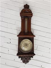 Sale 9085 - Lot 1011 - Victorian Carved Walnut Aneroid Barometer, with silvered dial, having mercury thermometer in Fahrenheit & Celsius - missing glass pa...