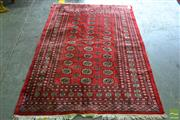 Sale 8559 - Lot 1084 - Pakistani Bokhara Wool Carpet, with triple column of guls, in red & grey tones, certificate in office (138 x 199cm)