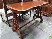 Sale 8634 - Lot 1041 - Victorian Walnut Occasional Table, with serpentine shaped top, turned carved end supports & stretcher