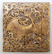 Sale 8800 - Lot 33 - A Chinese red lacquered carved gilt panel of a rising phoenix, 40 x 40cm