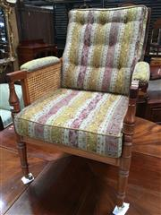 Sale 8666 - Lot 1009 - Paul Kenny Regency Style Rosewood Library Chair, with loose buttoned cushions, caned panel sides & turned legs on casters