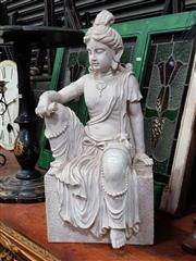Sale 8925 - Lot 1045 - A seated plaster figure of an indian goddess