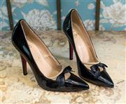 Sale 8577 - Lot 84 - A pair of designer Christian Louboutin Paris black patent leather stiletto heels featuring mesh and bow detail, size 39, Condition:...