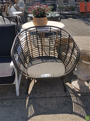 Sale 8601 - Lot 1223 - Modern Wicker Outdoor Tub Chair