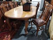 Sale 8760 - Lot 1050 - Maple Dining Setting incl. Extension Table with Two Leaves & Set of Eight Chairs incl. Two Carvers (winder in office)